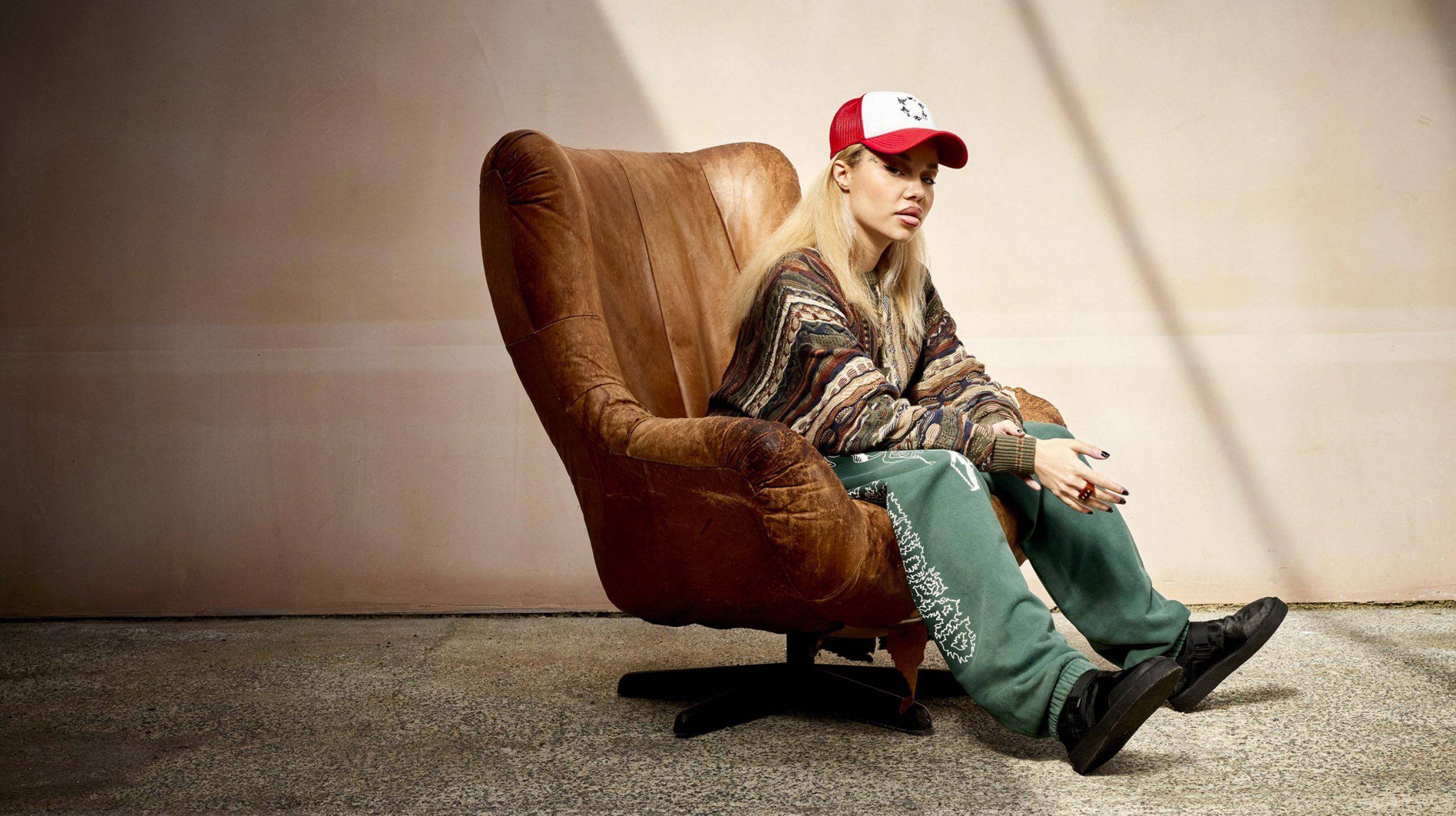 JGRREY sat in a worn brown leather arm chair