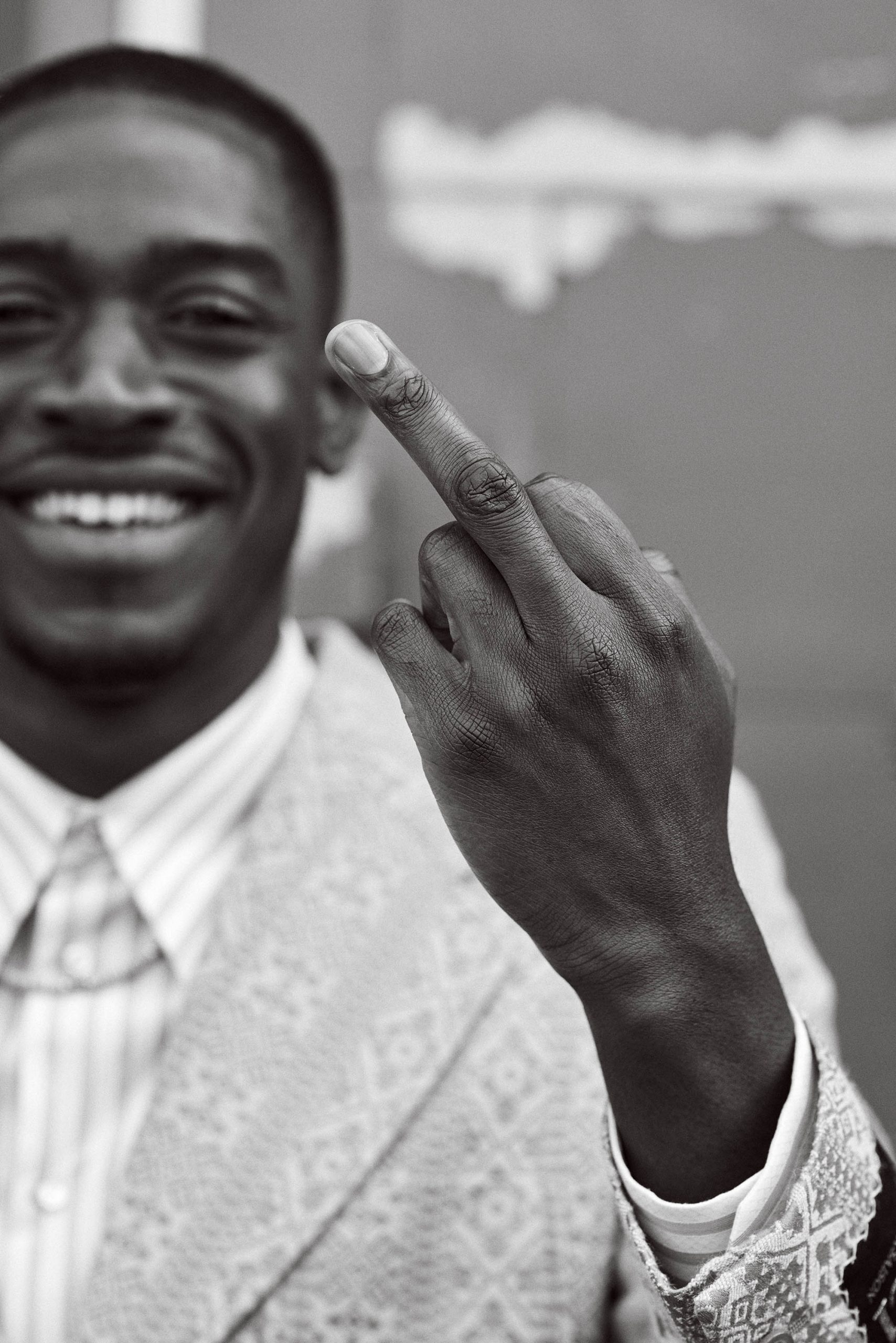 Damson Idris sticking his middle finger up at the camera